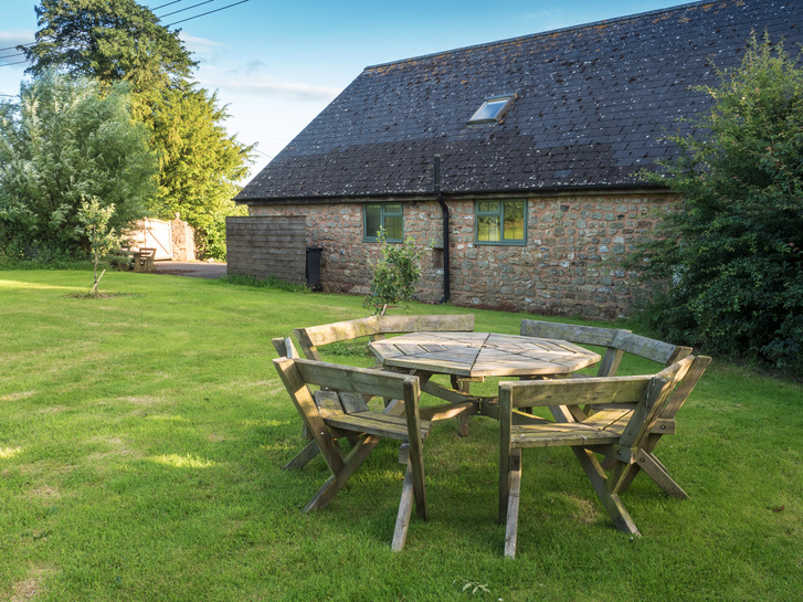 Seating area in garden of Higher Westcott. Self catering  holiday cottage in Devon