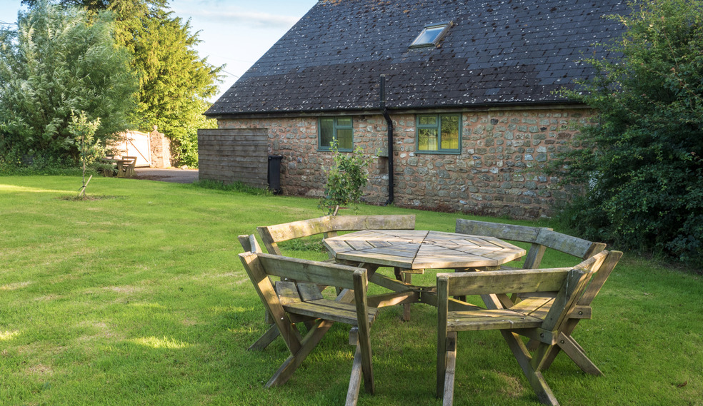 Seating area in garden of Higher Westcott. Self catering cottage for large group holidays in Devon