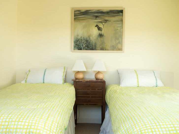 Twin bedroom with double aspect in Higher Westcott cottage. Self catering holidays for large groups in Devon